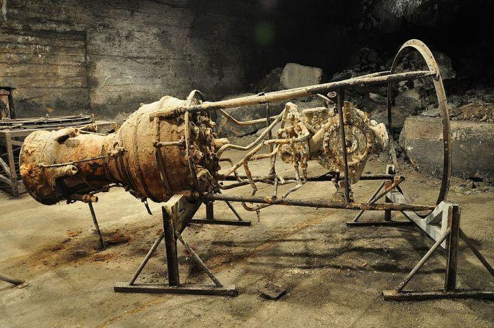 A rusting V-2 rocket engine, at the former slave factory Dora-Mittelbau. Photo by Vincent van Zeijst via wikipedia