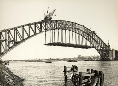 Sydney Harbour Bridge under construction on December 2nd, 1930, with the road decking being hung from the famed steel arches.  (State Records NSW, 12685 a00704 8731000013r)