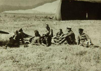 Von Richtofen and pilots of Jasta 11 relax on the aerodrome grass. (SDASM 02-V-00162)