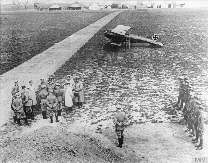 Kaisertruppenschau (Kaiser's Review). The Kaiser, Hindenburg, Falkenhayn and Ludendorf inspect Jasta 11 at Marcke Aerodrome, France, with an Albatros D.Va (possibly Richthofen's) on the field. IWM Q 379