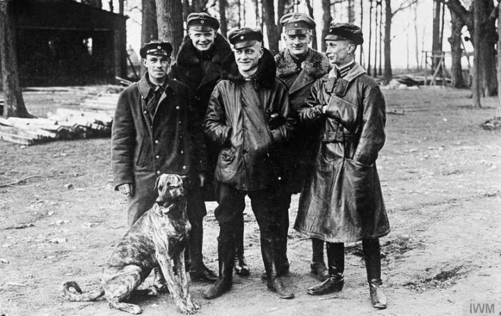 Jasta 11 pilots at Roucourt, France in March 1917, just days before Richthofen was shot down. Left to right are Vizefeldwebel Sebastian Festner (9 victories that month, killed on 23 April), Leutnant Karl-Emil Schäffer (14 victories), Oberleutnant Manfred von Richthofen (22 victories), Leutnant Lothar von Richthofen (14 victories) and Leutnant Kurt Wolff (21 victories). The dog is Moritz, Richthofen's beloved Danish hound. (IWM Q 42284)