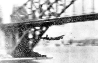 Queen's passage. A blurred but incomparable snap of Lancaster Mk I Q for 'Queenie VI' passing under Sydney Harbour Bridge, October 22nd, 1943.