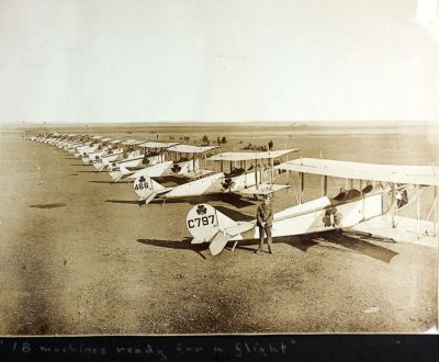 An ante-diluvian shot of Army Signal Corps Jennys on the flight line, during World War One. From a C Dorsey album (AL-19), SDASM.