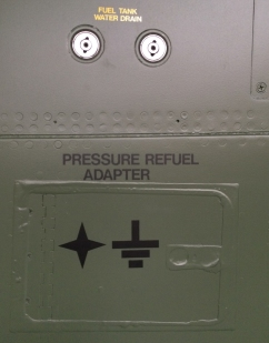 A feature that will be familiar to any pilot – fuel tank water drains, of which the F-111 has ...a lot. Below is the pressure fuel adapter door, sealed shut for display, along with most other maintenance doors and ports. (© airscape Photo)