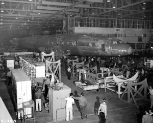 A C-69 fuselage (possibly the prototype) during construction. Despite their agrarian looks, the wooden cradles would offer precision support. (SDASM #00013536)