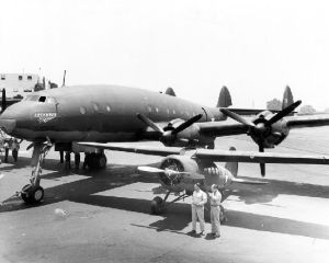 Prototype L-049/C-69-1-LO (c/n 1961, civil test registration NX25600 and USAAF serial 43-10309) on Lockheed's Burbank ramp in 1943, alongside a somewhat dwarfed UC-101 Vega 5C. (SDASM #00013538)