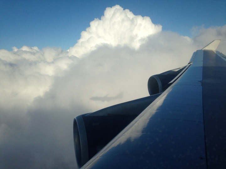 A 747 shows its shadow on the flank of a cumulus cloud over London, England. (Courtesy of Mark Vanhoenacker)