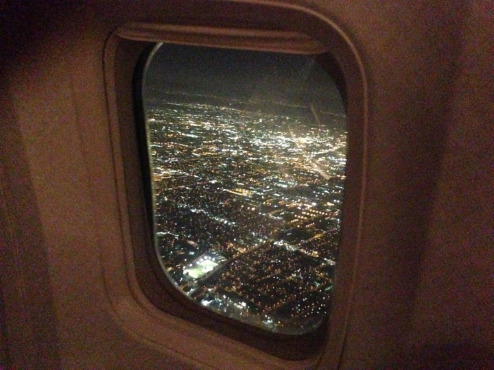 Los Angeles glitters beyond the cabin window, during a night approach to LAX. (Courtesy of Mark Vanhoenacker)