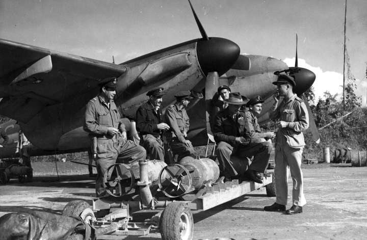 A RAAF crew load up their Mosquito FB (most likely a locally built Mk.40) in Burma. Note the under-wing hard points of the Fighter Bomber variants. (State Library of Victoria H98.100/1583)