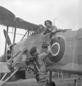 For a sense of scale... Radio Mechanics of the WRNS prepare to board a Fleet Air Arm aircraft to test the radio during a flight. (IWM 13359)