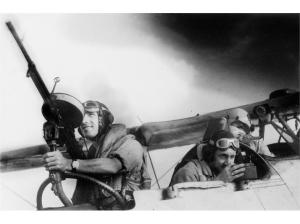 A carefully staged crew photo, showing the position of the air gunner, navigator and pilot. Guns weren't carried across the States, and most of the crew positions were filled by a (usually hungover) maintenance rating.