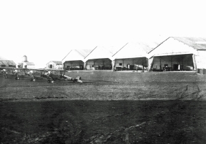Nieuport 23Ms in front of the canvas hangars at Field 3 of the 3rd AIC, Issoudun. With 11 operation air fields and four more under construction, the Issoudun complex was the largest airbase in the world by war's end. (Wikipedia)
