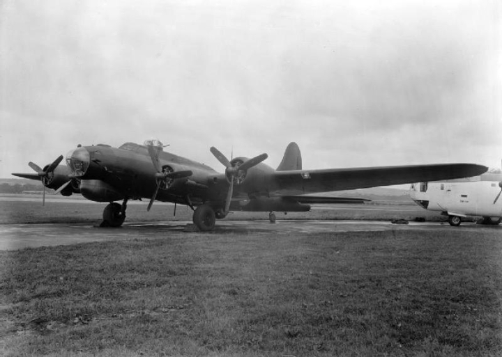 "Twin heavies... Another look at Fortress Mk. III HB796, ""G"" with a Coastal Command Liberator. The Fort's large under-nose fairing houses an American AN/APS15 radar unit. (IWM ATP 13090B)"