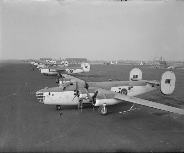 Liberator GR Mark IIIs, FK228 'M' and FL933 'O', of No. 120 Squadron RAF, lined up with other aircraft at Aldergrove, County Antrim, N.Ireland. The third aircraft in line is a GR Mark V, FL952, of No. 86 Squadron RAF. (IWM CH 18035)