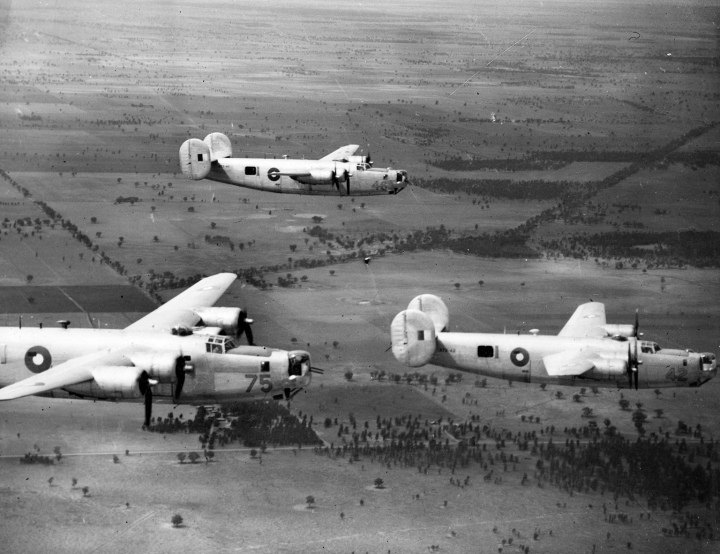 A trio of RAAF B-24s on a cross-country training flight with 7OTU, in late 1944. All built at San Diego, A72-42 is a B-24J-175-CO (44-40654); A72-46 is a B-24J-185-CO (44-40871); and A72-75 is a B-24L-1-CO (44-41403). (State Library of Victoria)