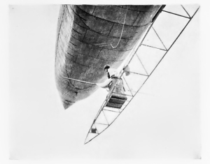 An extraordinary photograph of Santos-Dumont passing the top of the Eiffel Tower in Airship No.5, during his July 13th attempt. (Annual Report of the Smithsonian Inst., 1901)