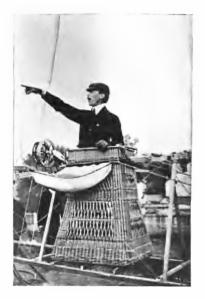 A triumphant Santos-Dumont, still in the basket of No.6, after landing back at the Paris Aero Club aerodrome at St.Cloud. (Dans l'Air, 1904)