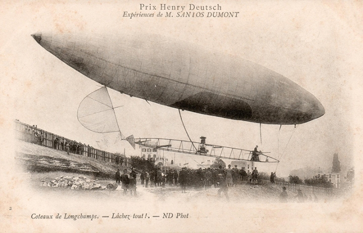 A period postcard showing Airship No.6 during its trials at Longchamps Racecourse, Paris. The caption translates as (On the) Embankments at Longchamps. Let go all! (wikimedia)