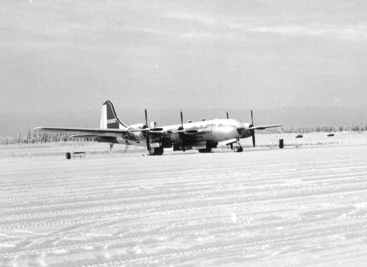 "WB-29 #229, one of #214's sisters, wears a blanket of snow Eielson AFB in late 1951. Note the ""bug catcher"" above the fuselage, and high visibility red tail. (Air Weather Assn 