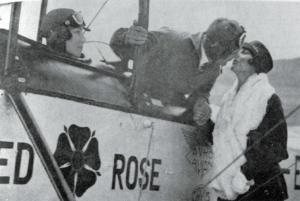 Triangulation... Lancaster kisses his wife Kiki farewell before the England-Australia flight, as Chubbie Miller looks on from the Avian's front cockpit. (© Lancaster family)