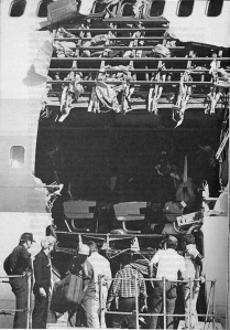 NTSB inspectors survey the damage to N4713U in the days after the incident. (NTSB)