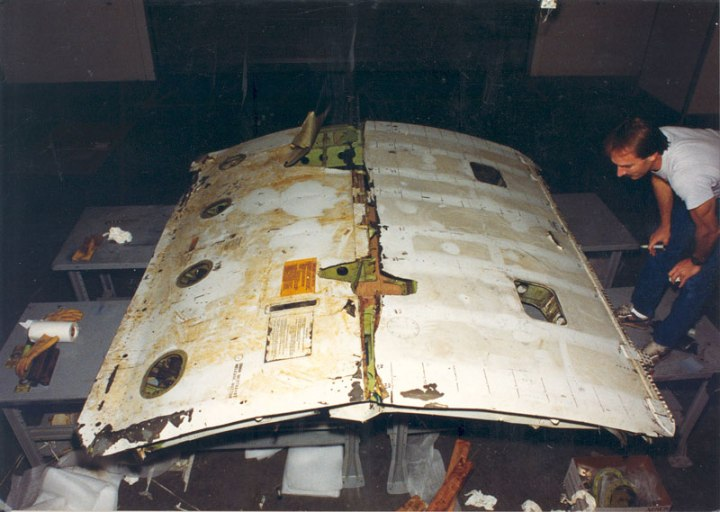 The cargo door from UAL811, after it was recovered in two parts off Oahu, in October 1990. The lower edge is to the left in this view. (FAA)