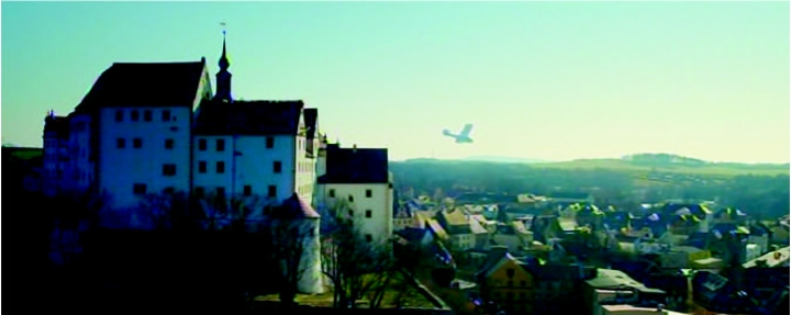 Falling with style... The completed replica leaves the castle roof (from by the clock tower, centre) and picks up flying speed. (© WIndfall Films)