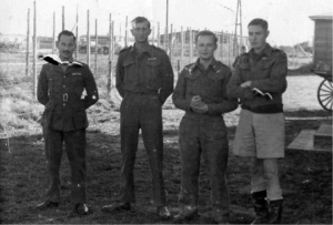 PoWs Bill Goldfinch (right) and Jack Best (second from left), the men behind the original Colditz Cock, at Stalag Luft III, Sagan, in 1942. (Courtesy of Pam Smith)