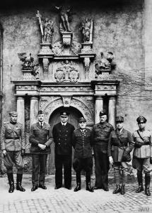 Senior officers of the Oflag IVC in front of Colditz Castle chapel. From left to right: Unidentified Yugoslavian Army Captain; Colonel de Smet, Belgian Army; Admiral Józef Unrug, Polish Navy; General Tadeusz Piskor, Polish Army; Colonel David Stayner, the Dorsetshire Regiment, British Army; General Le Bleu, French Army; Major E. Engles, Dutch Army. © IWM (HU 20269)