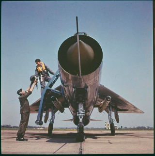 All shock cone and tailpipes... an RAF pilot boards his 'Frightning' in the mid-60s. © Crown copyright. IWM (RAF-T 5759)
