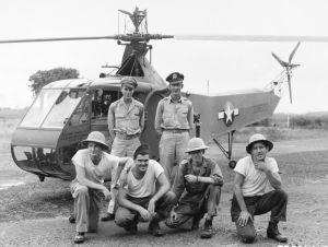 USAAF Second Lieutenant Carter Harman (standing, left) with his YR-4B and crew in 1944. Harman made the first helicopter combat rescue on April 23rd, 1944 in Burma. (© 2016 Igor I. Sikorsky Historical Archives, Inc.)