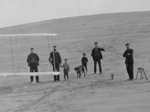 Before the abortive flight of December 14th, 1903, on the slope of the Big Kill Devil Hill. The boys and dog fled when Wilbur started the Flyer's motor. (Library of Congress)