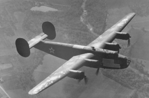 Another Ferrying Command B-24A - maybe even Old Bolts, but just nine in the USAAF's 1941 fleet. The large Stars & Bars on the nose and topsides identified the still neutral US ships, despite their British camouflage. (USAF)