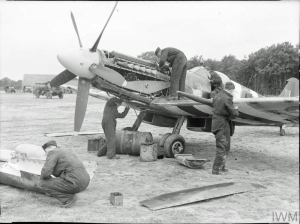 RAF No.91 Squadron ground crew attend to one of their Spitfire XIVs and its mighty Griffon at West Malling, Kent, in 1944. © IWM (CH 18183)