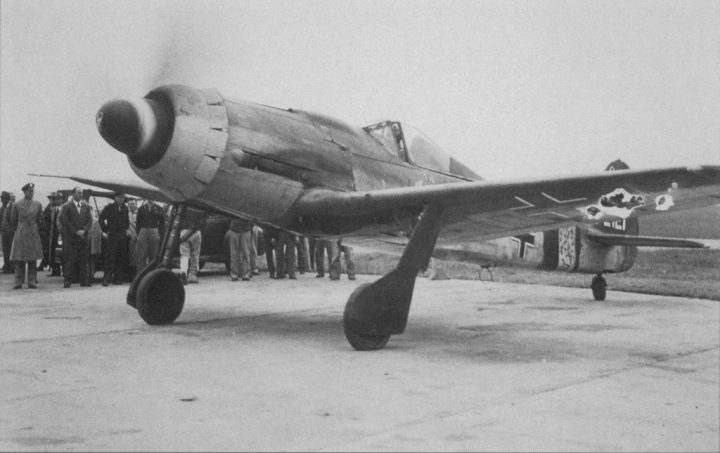 A FW.190-D9 is run up for a test flight. This version started to re-equip FW 190A units in October 1944. While intended mainly to engage escort fighters at altitude, many were committed to the 'Operation Bodenplatte' ground attacks of January 1st, 1945. (US National Archives RG 18)