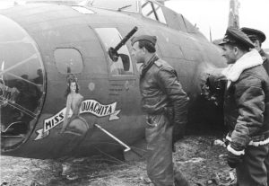 240-victory ace Heinrich Bär inspecting his 184th victim, Douglas-built B-17F 'Miss Ouachita' (42-3040) of the 91st BG, 323 BS, on February 22nd, 1944. (Bundesarchiv, Bild 101I-666-6875-05 / Rothkopf / CC-BY-SA 3.0, via wikipedia)