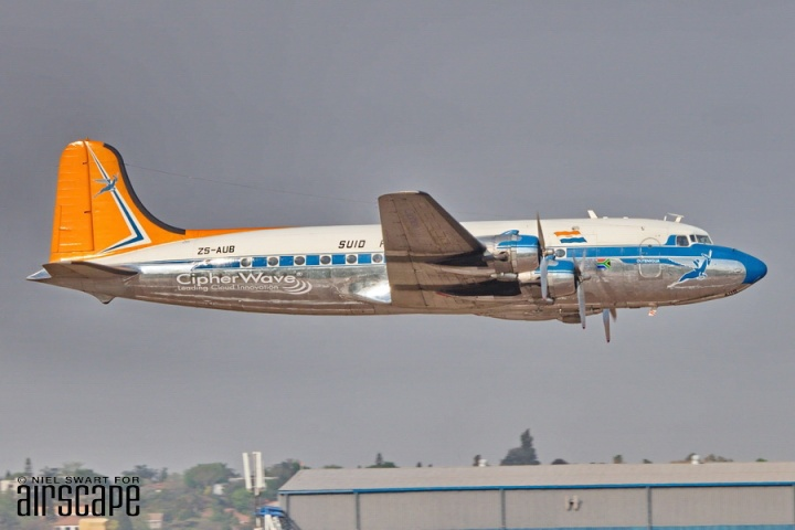 A great profile of SAA Museum Society's Douglas DC-4 ZS-AUB (cn 42984) as it makes a fast pass. Delivered in May 1946, this airliner served with SAA until 1967, before the usual medley of pre-restoration service and storage. (© Niel Swart)