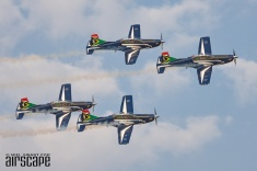 Established in 1946 as the 'Bumbling Bees', flying Harvards, the SAAF Silver Falcons display team make a formation pass in their current Pilatus PC-7 Mk.II trainers. (© Niel Swart)
