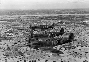 "Three Spitfire LF Mk.Vb Trop over North Africa. The lead aircraft IR-G is piloted by Wing Commander Ian Richard ""Widge"" Gleed, 244 Wing. He was shot down and killed in the Cap Bon area of Tunisia on April 16th, 1943. (LoC P&P fsa.8e00953)"