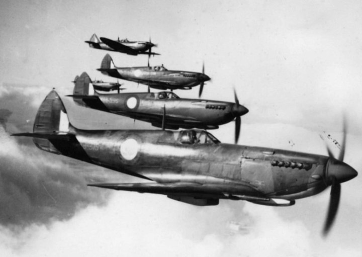 On the prowl... Spitfire LF Mk.VIIIs of the RAAF, on patrol – identified are A58-315 (JG377); and A58-395 (JF934). (State Library of Victoria)