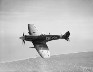 Showing the clipped wings of a low-level fighter, Spitfire Mk.XII 'EB-B' of 41 Squadron RAF performs for the camera in April 1944. (©IWM CH 12752)