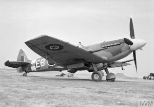 'EB-B' again, this time on the ground at Friston, with a slipper tank between its undercarriage to give extra 'legs' for the thirsty Griffon. (©IWM CH 12726A)