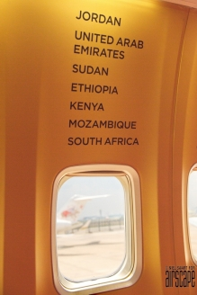 The cabin interior is decorated with Tour destinations.
